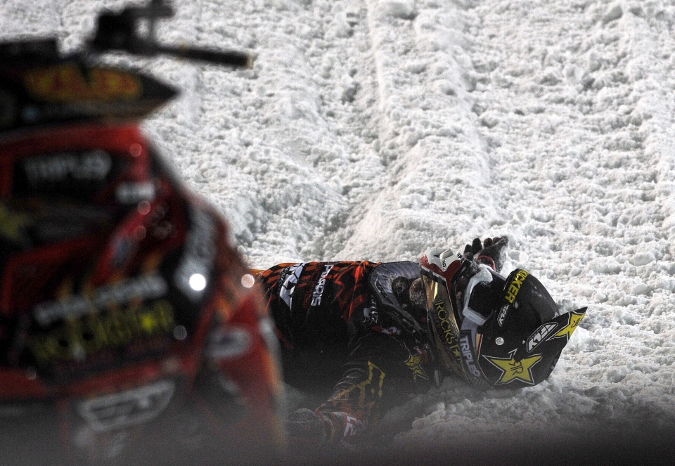 Caleb Moore lies in the snow after he crashed during the snowmoblie freestyle event at the Winter X Games in Aspen, Colo., on Jan. 24, 2013. Moore remains in critical condition in a Colorado hospital after this dramatic crash. (AP Photo/The Colorado Springs Gazette/Christian Murdock)
