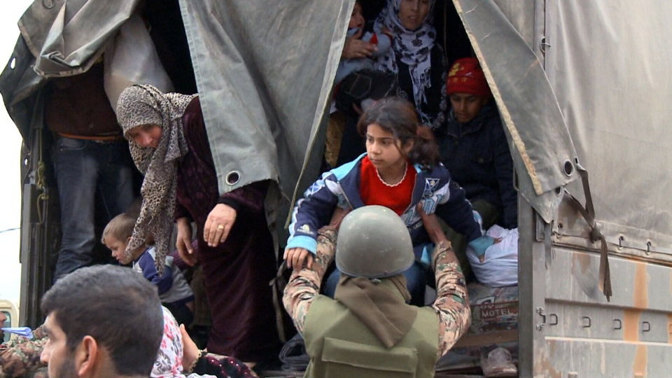 Syrian refugees arrive in Tal Shehab, Jordan on Tuesday, Jan. 29, 2013.