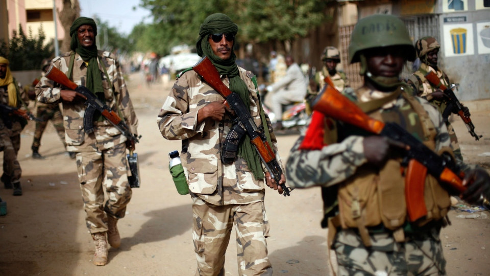 Chadian soldiers patrol the streets of Gao, northern Mali on Tuesday Jan. 29, 2013. (AP / Jerome Delay)