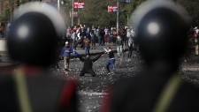 Egyptian protesters clash with riot police near Ta