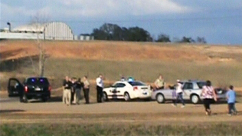 Authorities at the scene of a standoff in Alabama, Wednesday, Jan. 30, 2013