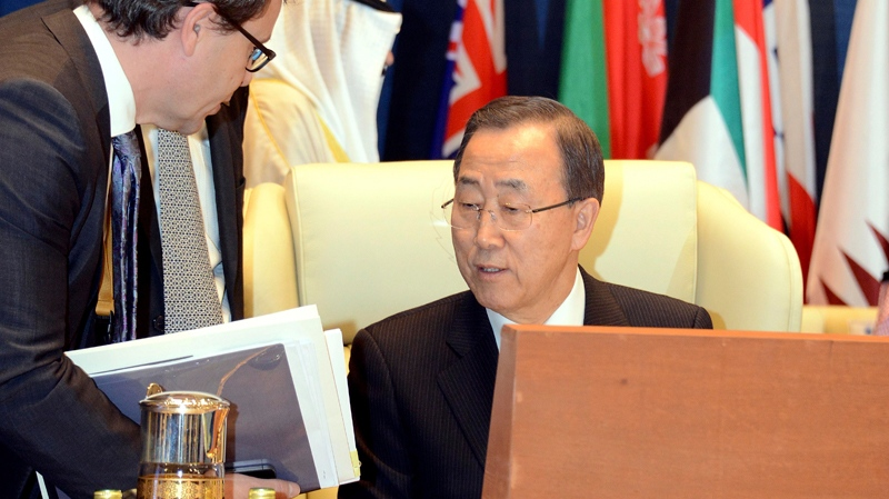 UN Secretary-General Ban Ki-Moon confers with colleagues during the opening of the International Humanitarian Pledging Conference for Syria at Bayan Palace, Kuwait City, Kuwait on Wednesday, Jan. 30, 2013. (AP Photo/Gustavo Ferrari)