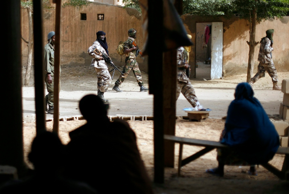 Chadian troops patrol the streets in Gao, northern Mali, on Jan. 29, 2013, days after Malian and French military forces closed in and retook the town from Islamist rebels. (AP Photo/Jerome Delay)