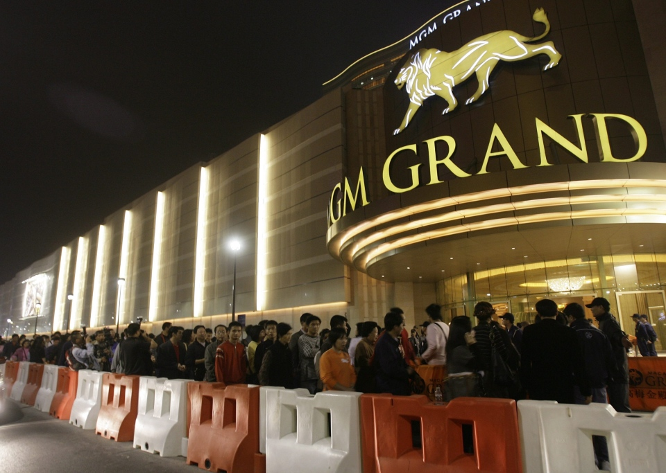In this Dec. 18, 2007 file photo, visitors queue up for entry of the new MGM Grand Macau casino resort after the opening ceremony in Macau. (AP / Vincent Yu)