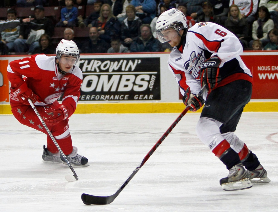 November 5, 2009 file photo of Sault Ste. Marie Greyhounds' Vern Cooper and Windsor Spitfires' Ryan Ellis in OHL hockey action at the WFCU Centre in Windsor, Ontario. (THE CANADIAN PRESS/Greg Plante)