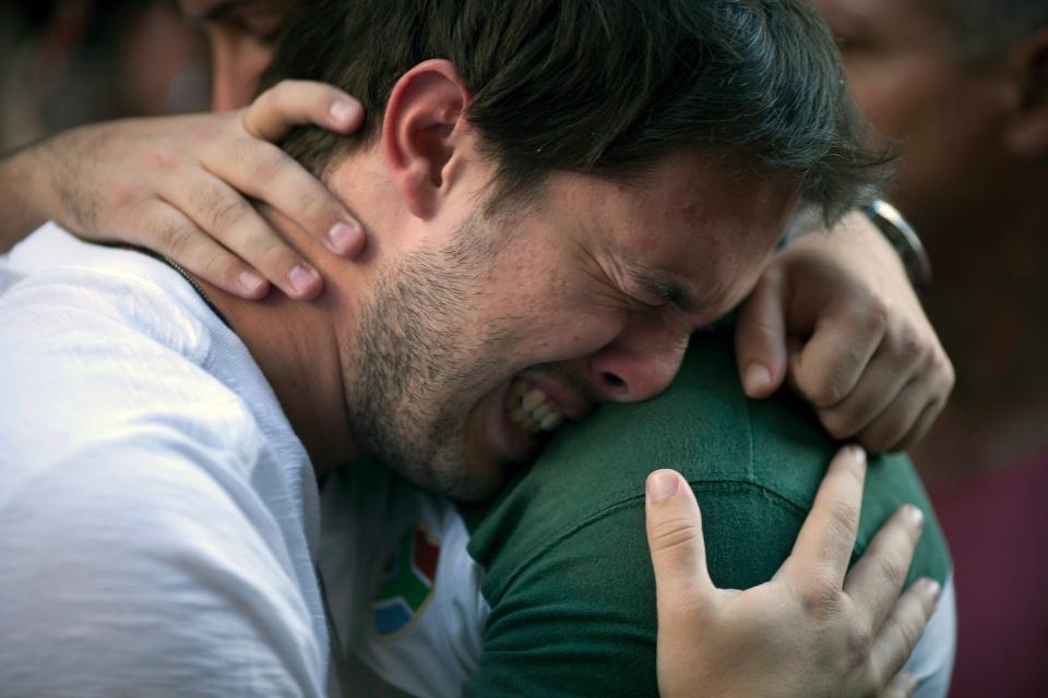 A man cries during a protest near the Kiss nightclub where a fire killed over 230 people in Santa Maria, Brazil, on Jan. 29, 2013. (AP / Felipe Dana)
