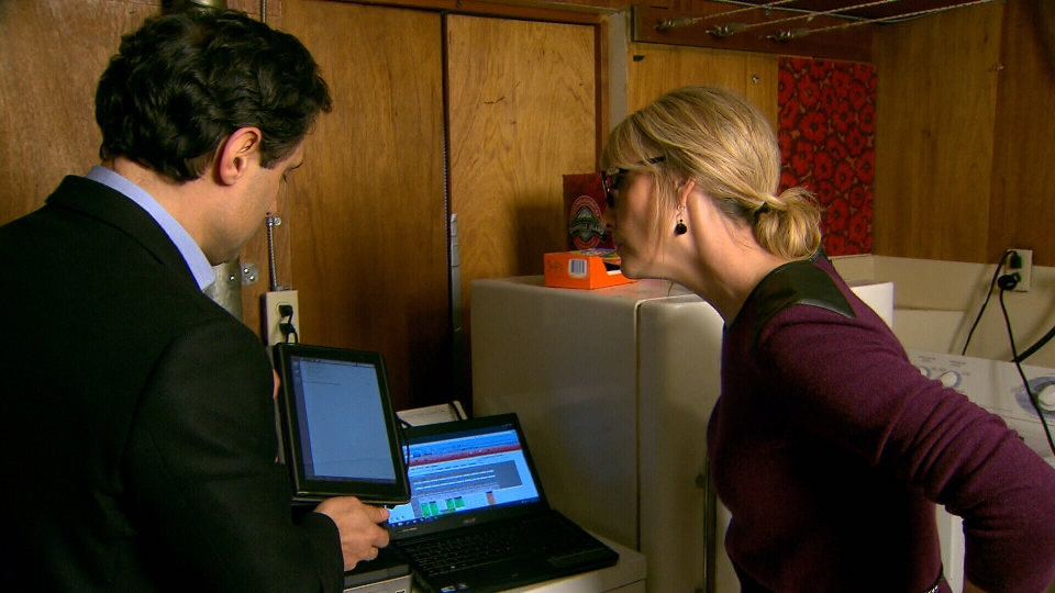 Pro Ace owner Ali Soroush shows Lynda Steele a new software program that lets him monitor and support his technicians real-time in the field. Jan. 31, 2013. (CTV)