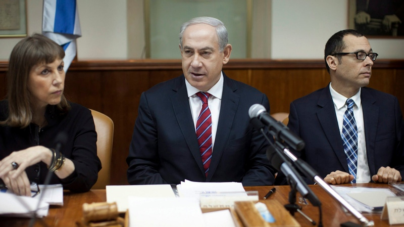 Israeli Prime Minister Benjamin Netanyahu, centre, heads the weekly cabinet meeting in his Jerusalem office, Sunday, Jan. 6, 2013. (AP / Uriel Sinai)