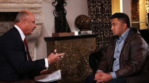 """In this Jan. 24, 2013, photo provided by CBS Television Distribution/Peteski Productions, talk show host Dr. Phil McGraw, left, interviews Ronaiah Tuiasosopo during taping for the """"Dr. Phil Show"""" in Los Angeles. (AP Photo / CBS Television Distribution / Peteski Productions)"""