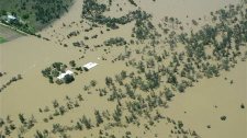 In this aerial photo provided by the Queensland Police, a property is covered in floodwaters near Emerald, Australia, Sunday, Jan. 2, 2011. (AP / Queensland Police)