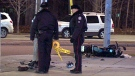 Police investigate the scene of a collision involving a motorcycle at McCowan Road near Ellesmere Road on Jan. 2, 2011.