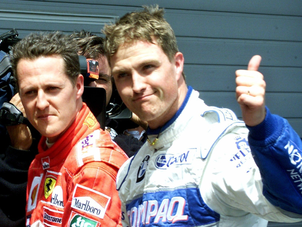 Germany's Ralf Schumacher, right, gives the thumbs-up after coming in second behind his brother Michael Schumacher, left, at the qualifying for the Grand Prix of Europe at the Nuerburgring, Saturday, June 23, 2001. (AP / Frank Augstein)