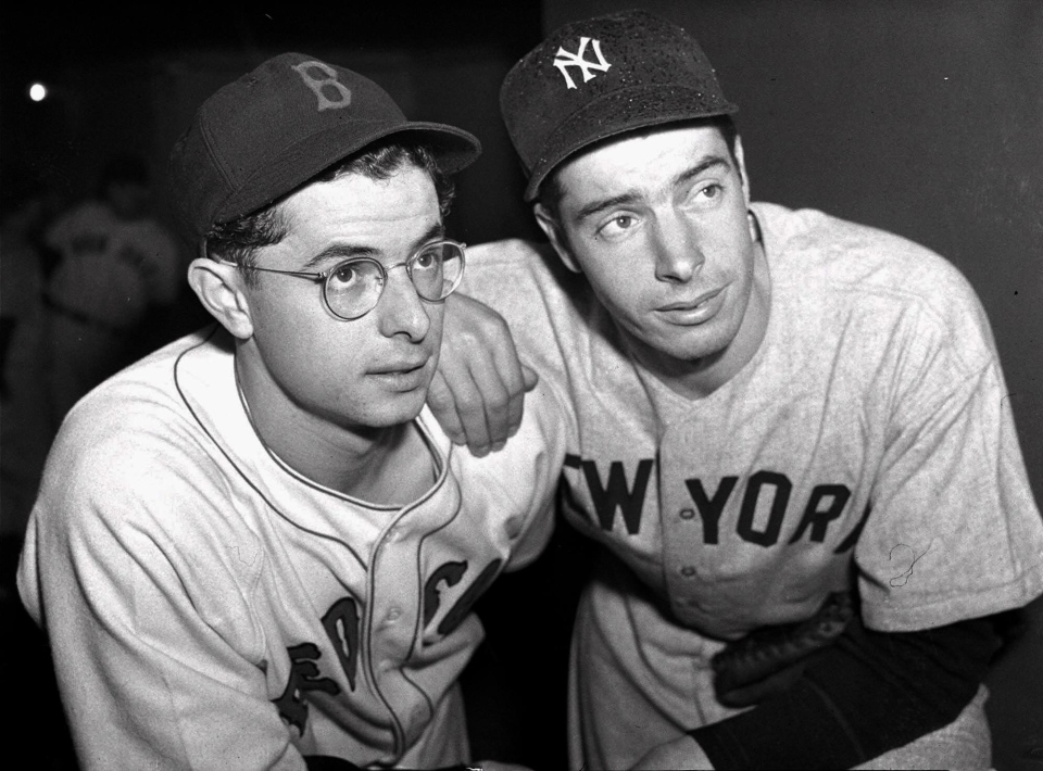 Two of the brothers DiMaggio, Dominic, left of the Boston Red Sox, and Joe, right, of the New York Yankees, pose April 25, 1940. (AP / file)