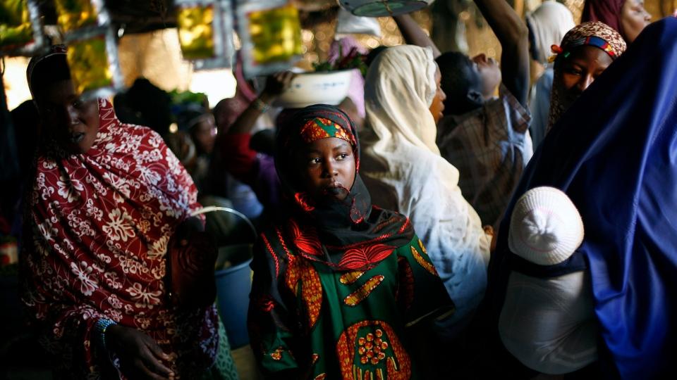 Malian women flock the central market in Gao, Northern Mali, Wednesday Jan. 30, 2013. (AP Photo /J erome Delay)