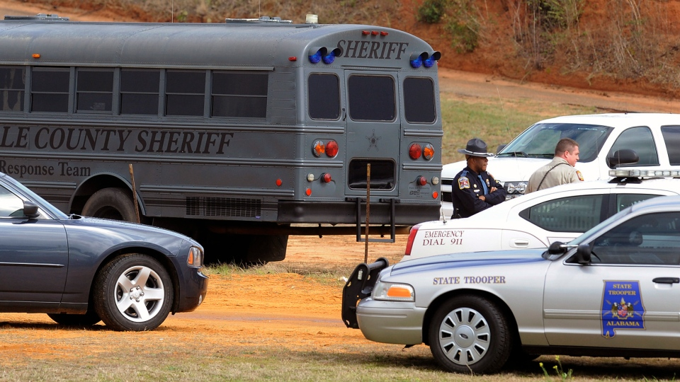 Police SWAT teams and hostage negotiators are gathered at standoff and hostage scene in Dale County near Ozark, Ala. on Wednesday Jan. 30, 2013. (The Montgomery Advertiser, Mickey Welsh)