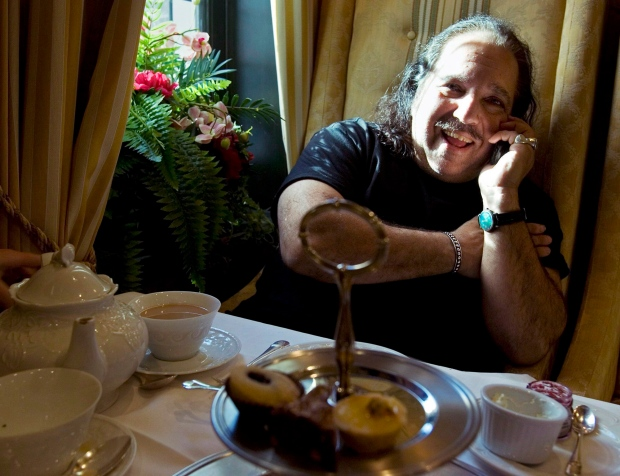 March 13, 2007 file photo of Ron Jeremy chatting on the phone at the Windsor Arms hotel in Toronto. (THE CANADIAN PRESS/Frank Gunn)