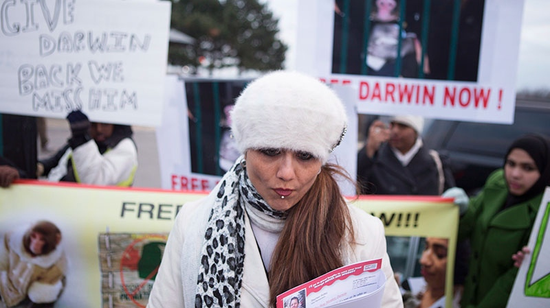 Yasmin Nakhuda stands with supporters outside an Animal Services offices in Toronto on Wednesday December 19, 2012. (Chris Young / /THE CANADIAN PRESS)