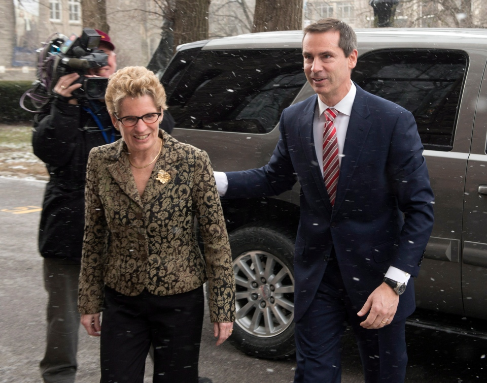 Ontario Premier Dalton McGuinty  escorts incoming premier Kathleen Wynne to Lt.-Gov. David Onley's suite at the Ontario Legislature in Toronto on Thursday Jan. 31, 2013. (Frank Gunn /  THE CANADIAN PRESS)