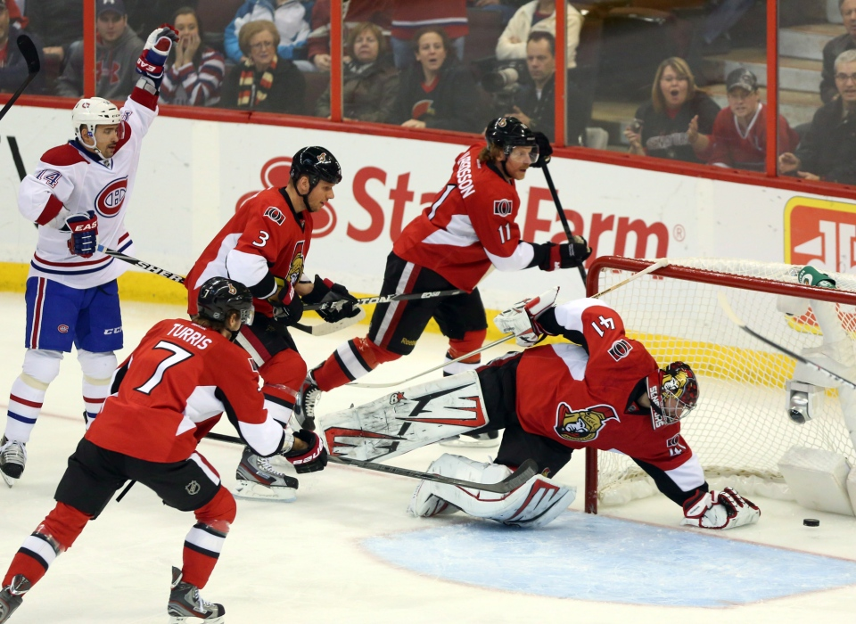 Montreal Canadiens' Tomas Plekanec, left, celebrates his goal as Ottawa Senators goltender Craig Anderson stretches for the puck and Senators' Daniel Alfredsson (11) and Kyle Turris (7) and Marc Methot (3)look on during first period NHL hockey action in Ottawa Wednewsday January 30, 2013. THE CANADIAN PRESS/Fred Chartrand