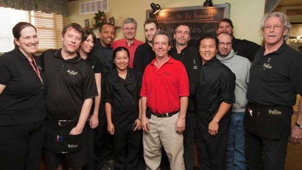 Stephen Harper poses with Prescott staff