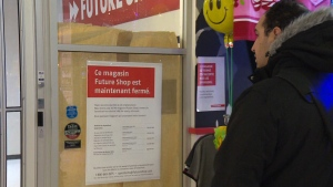 A man looks at a sign posted on a Future Shop door, notifying customers that the location has closed, Thursday, Jan. 31, 2013.