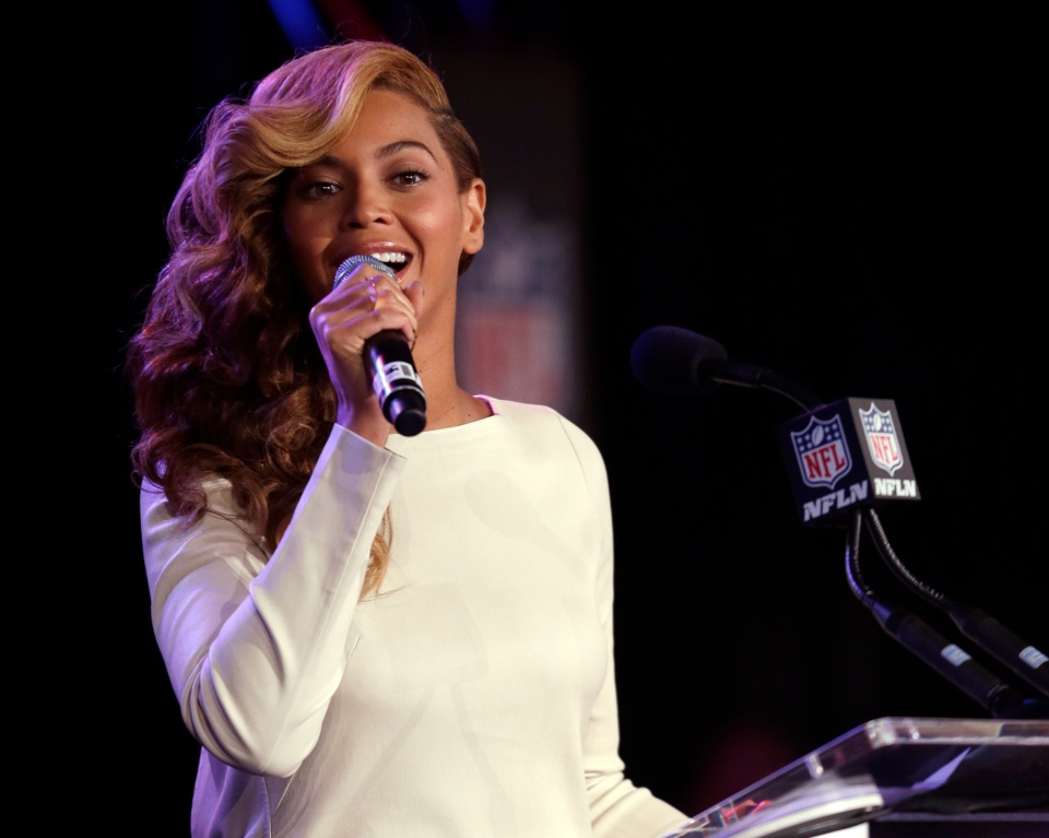 Beyonce sings the national anthem during a news conference, in New Orleans, Thursday, Jan. 31, 2013. (AP / Morry Gash)