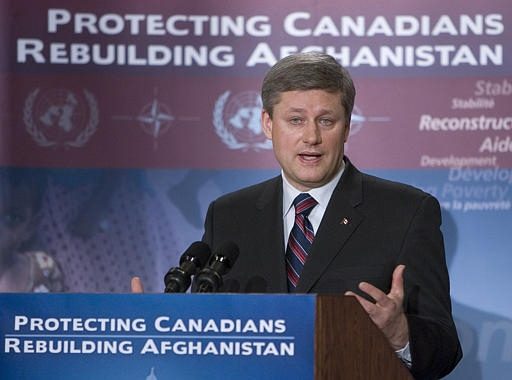 Prime Minister Stephen Harper responds to reporters' questions in Ottawa on Monday after announcing new funding for aid in Afghanistan. (CP / Tom Hanson)