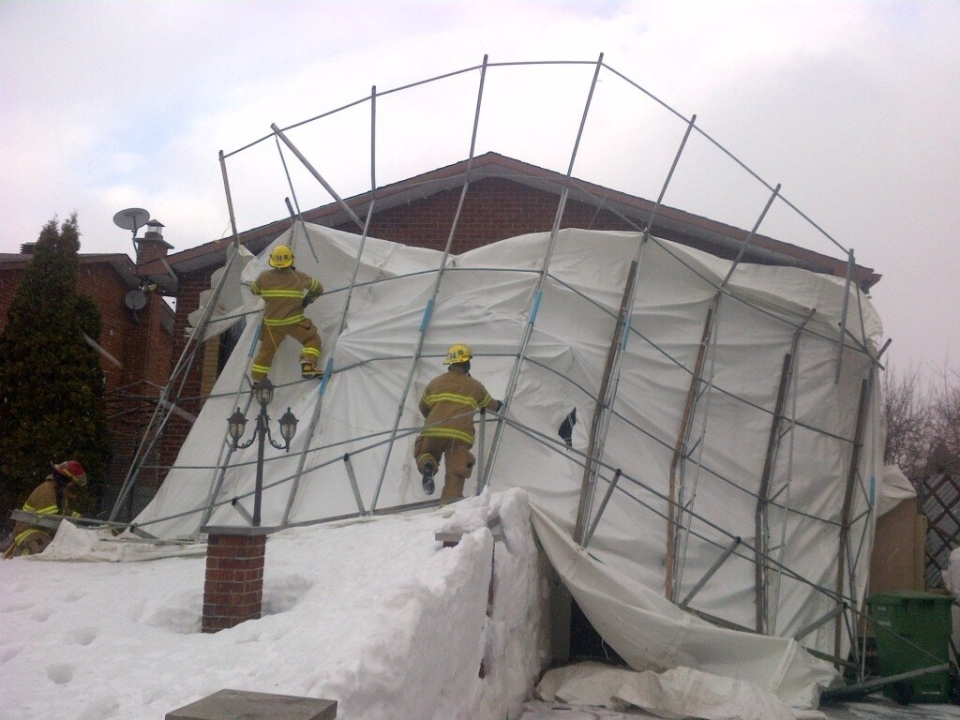 A collapsed car shelter in Riviere-des-Prairies. (From Twitter via MyBubby)