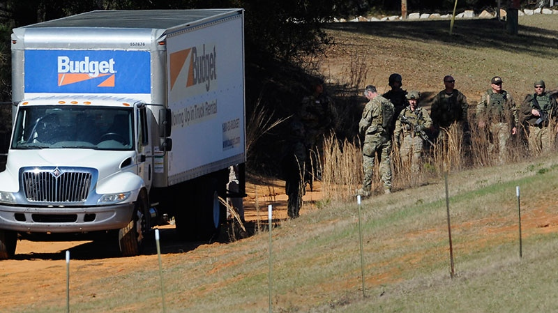 Authorities gather at the Dale County hostage scene in Midland City, Ala. on Thursday morning, Jan. 31, 2013. (The Montgomery Advertiser, Mickey Welsh)