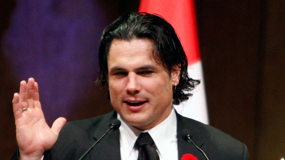 Senator Patrick Brazeau accepts the Bad Sport Award at the National Press Gallery Dinner Saturday in Gatineau, Que., Saturday, Nov. 3, 2012. (Fred Chartrand  / THE CANADIAN PRESS)