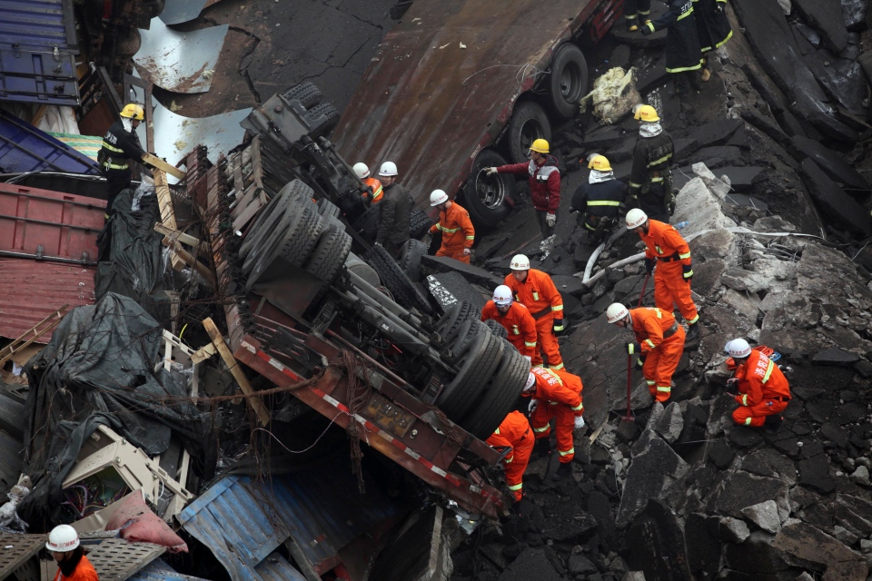 Rescuers work at the accident site where an expressway bridge partially collapsed due to a truck explosion in Mianchi County, Sanmenxia, central China's Henan Province, Thursday, Feb. 1, 2013. (AP Photo)
