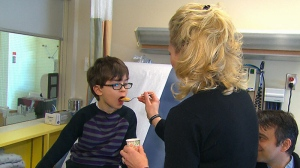 A doctor gives a child allergic to peanuts pudding that contains peanuts in hopes of desensitizing him against his condition.