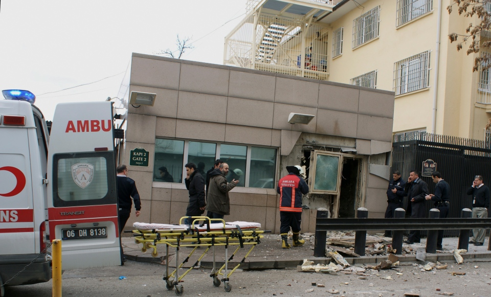 Gate 2 of the embassy just after a suicide bomber had detonated an explosive device at the entrance of the U.S. Embassy in the Turkish capital, Ankara, Turkey, Friday, Feb. 1, 2013. (AP / IHA)