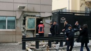 Gate 2 of the embassy just after a suicide bomber detonated an explosive device at the entrance of the U.S. Embassy in the Turkish capital, Ankara, Turkey, Friday, Feb. 1, 2013. (AP / IHA)