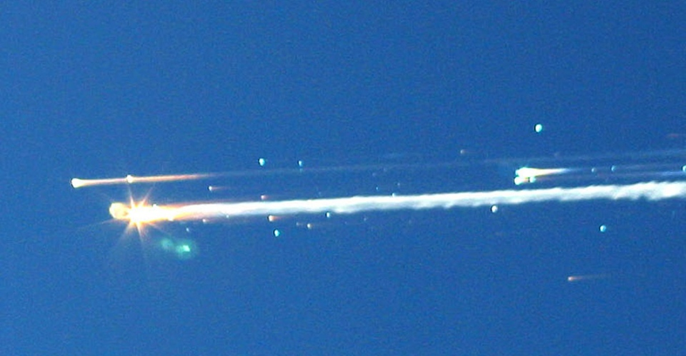 In this Feb. 1, 2003 file photo, debris from the space shuttle Columbia streaks across the sky over Tyler, Texas. (AP Photo/Scott Lieberman)
