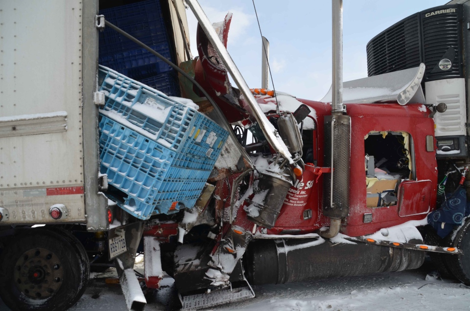 Damaged vehicles are seen following a multi-vehicle crash on the eastbound Highway 401 near Woodstock, Ont. on Friday, Feb. 1, 2013. (Andrew Collins / CTV News)