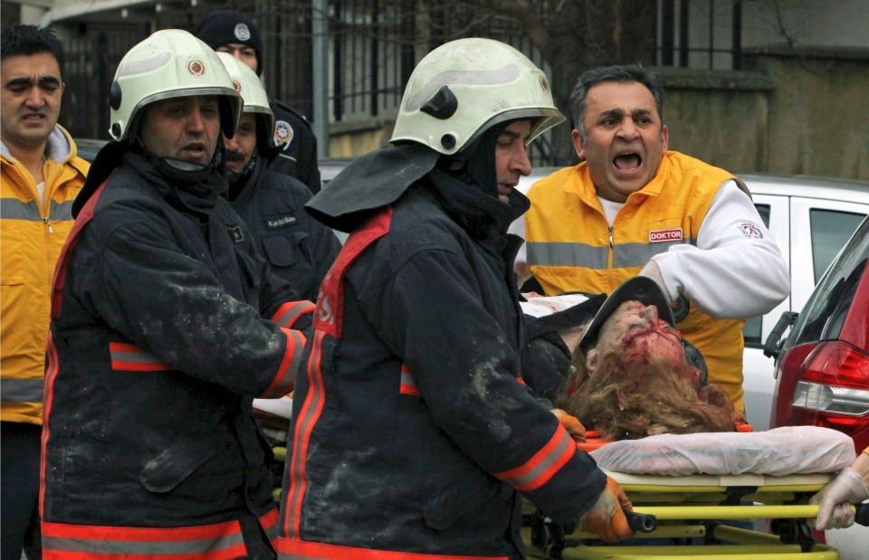 Medics carry an injured woman on a stretcher to an ambulance after a suspected suicide bomber detonated an explosive device at the entrance of the U.S. Embassy in the Turkish capital, Ankara, Turkey, Friday Feb. 1, 2013. (AP / Burhan Ozbilici)