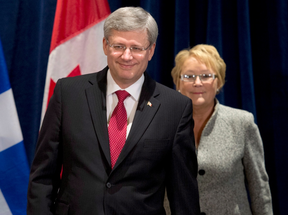 Prime Minister Stephen Harper and Quebec Premier Pauline Marois walk in to participate at an announcement in Levis, Que., Friday, Feb. 1, 2013. (Jacques Boissinot / THE CANADIAN PRESS)