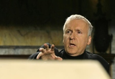 Canadian director James Cameron gestures as he refers to one of two limestone ossuraries during a press conference in New York on Monday. (AP / Kathy Willens)