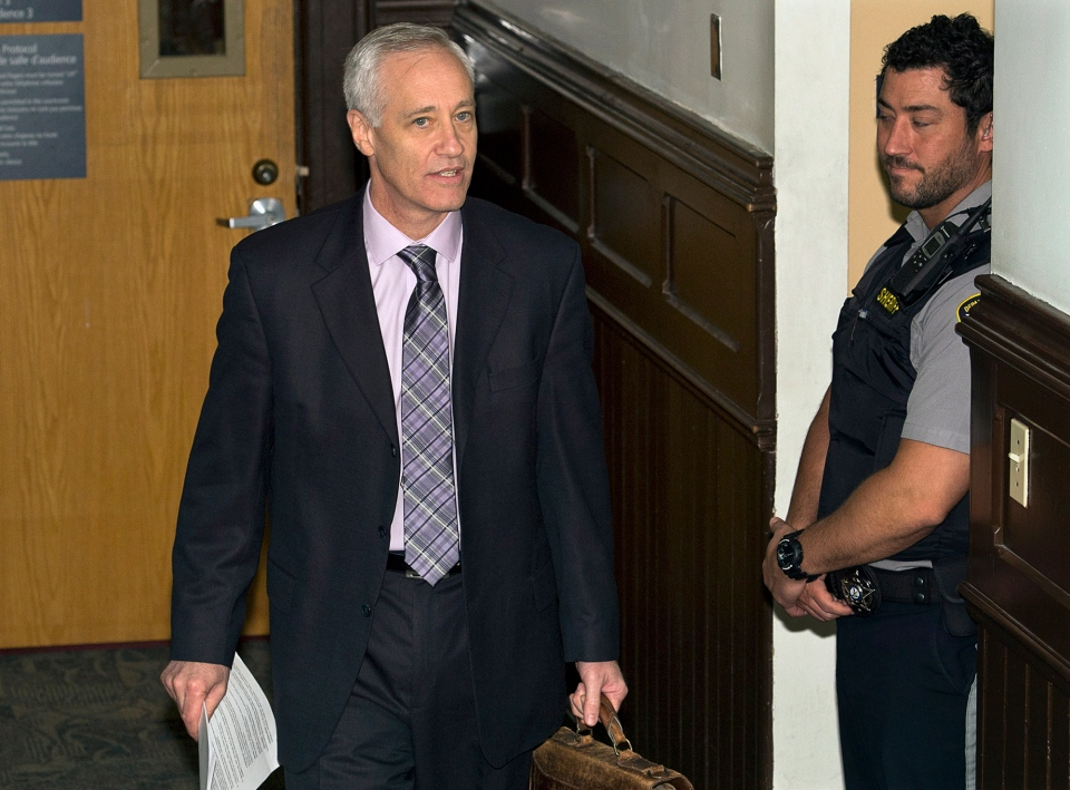 Mike Taylor, lawyer for Sub-Lt. Jeffrey Paul Delisle, heads from Nova Scotia provincial court after a sentencing hearing in Halifax on Friday, Feb. 1, 2013. (Andrew Vaughan / THE CANADIAN PRESS)