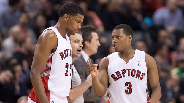 Toronto Raptors forward Rudy Gay, left, talks with Raptors guard Kyle Lowry, right, while playing against the Los Angeles Clippers during first half NBA basketball action in Toronto on Friday, Feb. 1, 2013. (The Canadian Press/Nathan Denette)