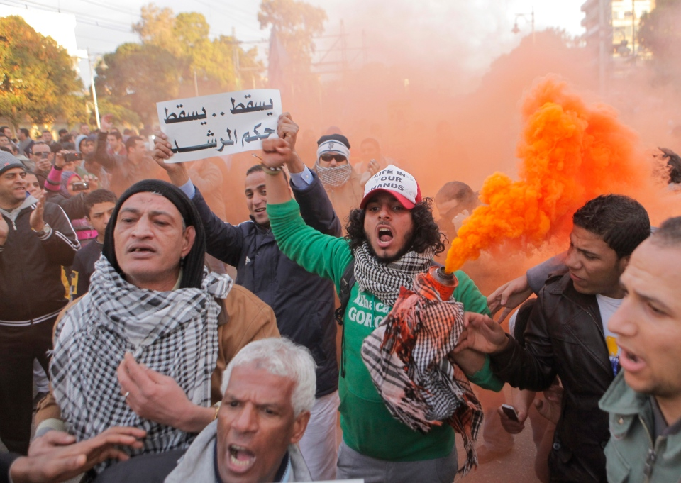 Egyptians shout slogans during anti-President Mohammed Morsi protest in front of the presidential palace in Cairo, Egypt, Friday, Feb. 1, 2013. (AP / Amr Nabil)