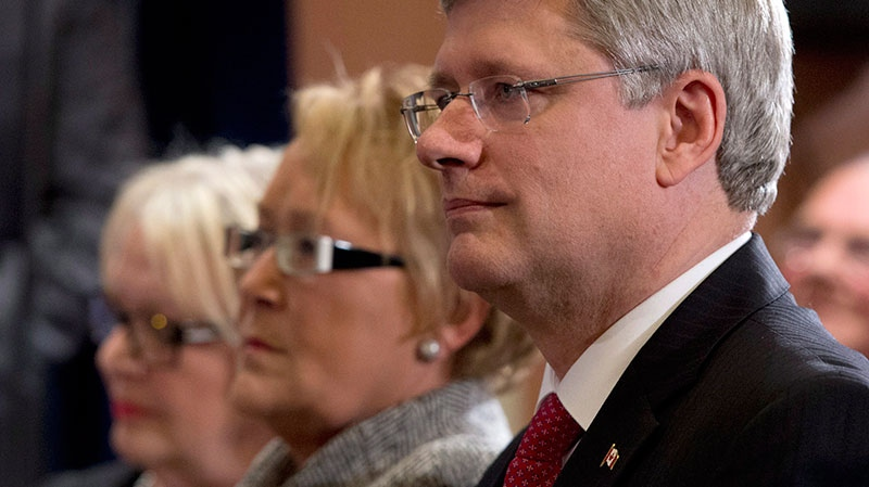 Prime Minister Stephen Harper, Quebec Premier Pauline Marois and Levis mayor Danielle Roy Marinelli listen to an announcement in Levis, Que., on Friday, Feb. 1, 2013. (Jacques Boissinot / THE CANADIAN PRESS)