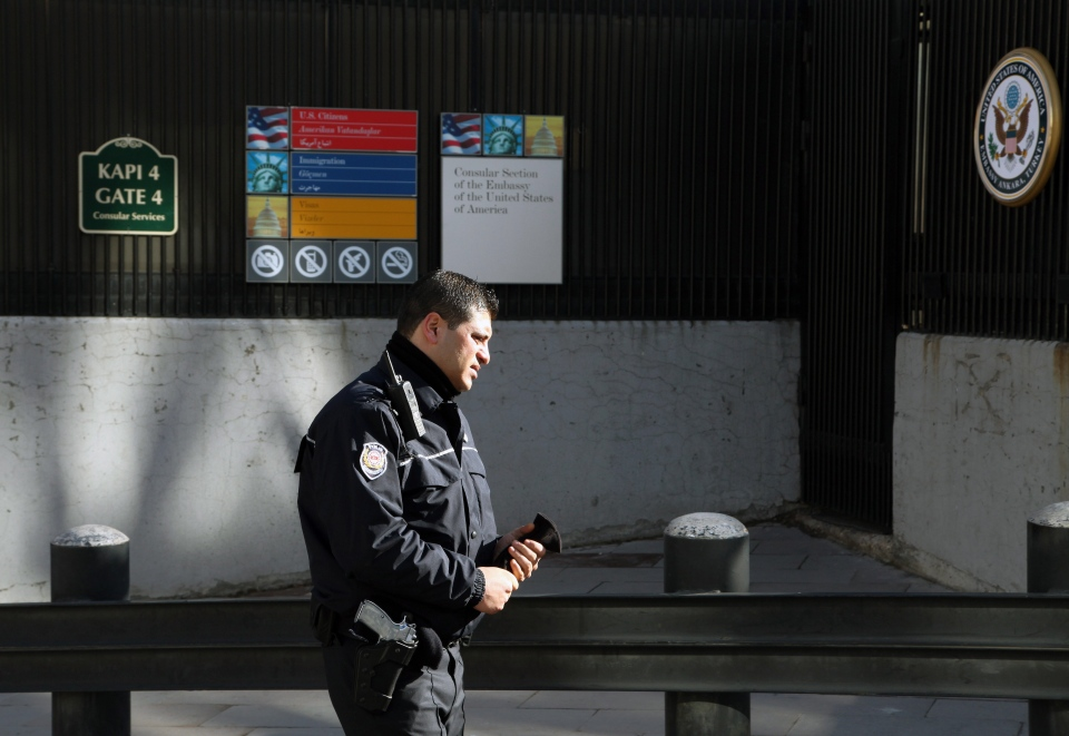 A Turkish security member stands outside a day after a suicide bomber struck the American Embassy in Turkish capital on Friday, killing a Turkish security guard in what the White House described as a terrorist attack, in Ankara, Turkey, Saturday, Feb. 2, 2013. (AP / Burhan Ozbilici)