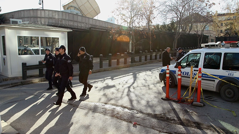 Turkish security members patrol outside American Embassy a day after a suicide bomber attack, in Ankara, Turkey, Saturday, Feb. 2, 2013. (AP / Burhan Ozbilici)