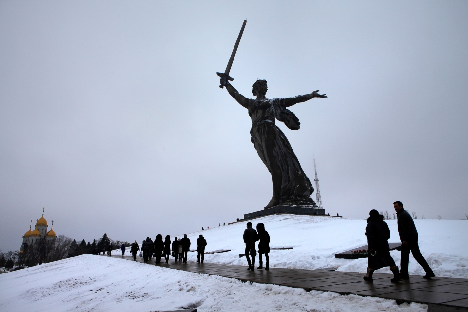 People walk past the monument to Motherland during ceremonies marking the 70th anniversary of the Battle of Stalingrad in the southern Russian city of Volgograd, once known as Stalingrad, on Feb. 2, 2013. (AP / Alexander Zemlianichenko)