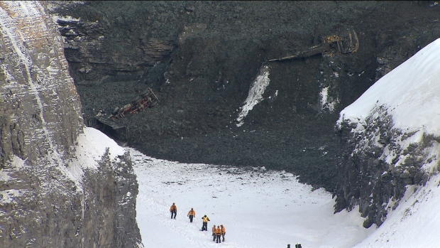 While searching for missing workers, rescue crews found a body in a Quebec quarry in L'Epiphanie, Que., Saturday, Feb. 2, 2013.