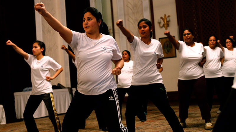 Female staff members of Hotel Imperial practice during a 12-day self-defense course initiated by the hotel management and Delhi Police women's wing in New Delhi, India, Friday, Feb. 1, 2013. (AP / Altaf Qadri)