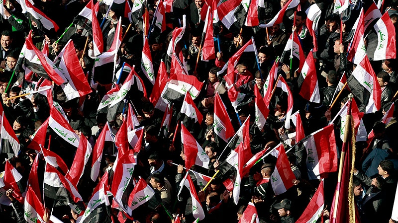 Shiite demonstrators chant pro-government slogans and wave national flags, to show support for Prime Minister Nouri al-Maliki in Baghdad, Iraq, Saturday, Jan. 12, 2013. (AP / Hadi Mizban)