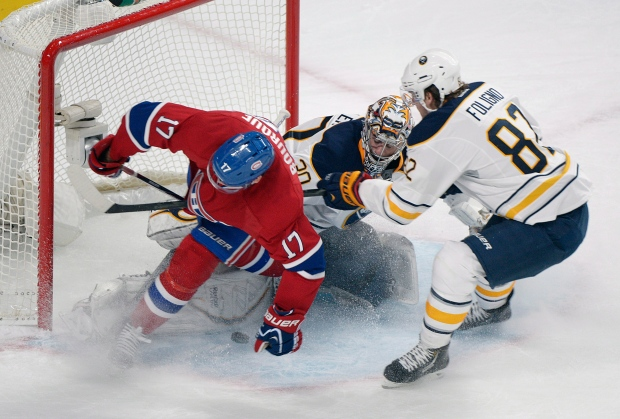 Montreal Canadiens' Rene Bourque slides in on Buff